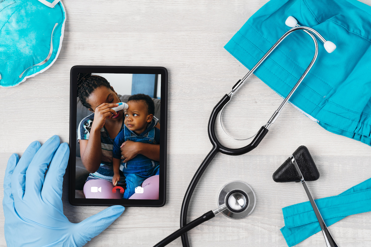 Doctor and patient having a telehealth video chat